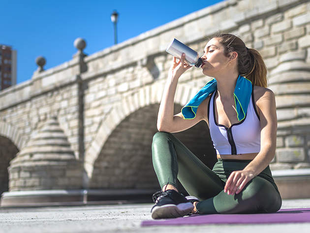 drinking from water bottle running woman