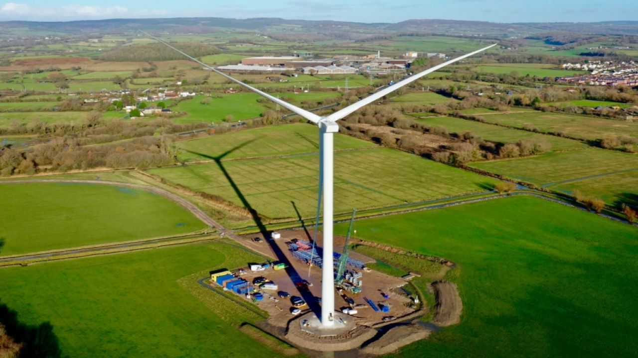 Budweiser Brewing Group's Magor brewery in the UK currently meets 20% of its power needs from a wind turbine installed in December 2020. Credit: AB InBev UK Limited.